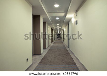 Very long corridor in a hotel - stock photo