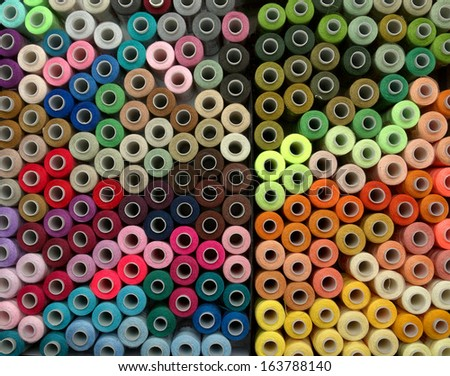 very many reels of threads for embroidery, colorful, background - stock photo