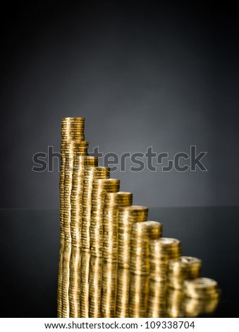 very many rouleau gold  monetary or change coin, on dark background - stock photo