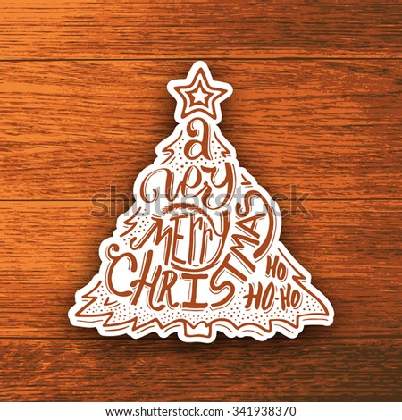 Very Merry Christmas typographic label isolated on wood. Background with hand lettering for christmas. Doodle christmas tree. Merry Christmas greeting card.  - stock photo