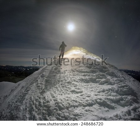 very mysterious and fantastic full moon snow space of high mountains Ukraine- Ukrainian Carpathians, carved by the winds, blizzards, storms and snowfall in decorative patterns and figures - stock photo