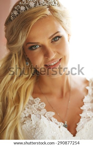 Very nice and bright bride sits on a chair