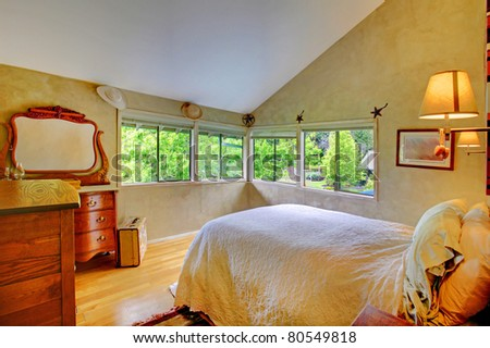 Very nice horse ranch with large bedroom in yellow tones - stock photo