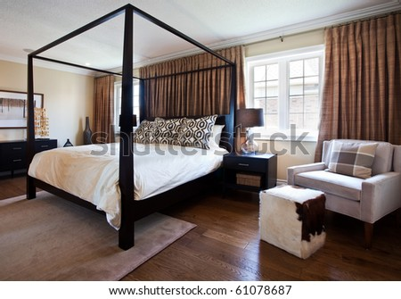 Very nicely decorated bedroom in a model home - stock photo