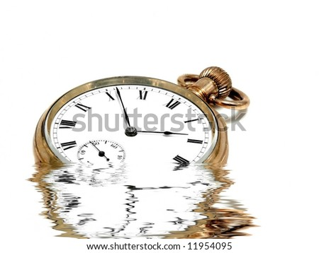 Very old and beautiful pocket clock in gold reflected in water