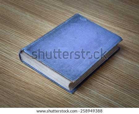 Very old books on desk, books are around 100 years old - stock photo
