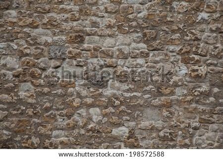 Very old castle wall background - stock photo