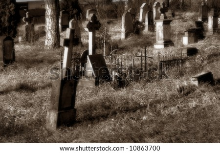 Very old cemetery, in sepia with soft focus - stock photo