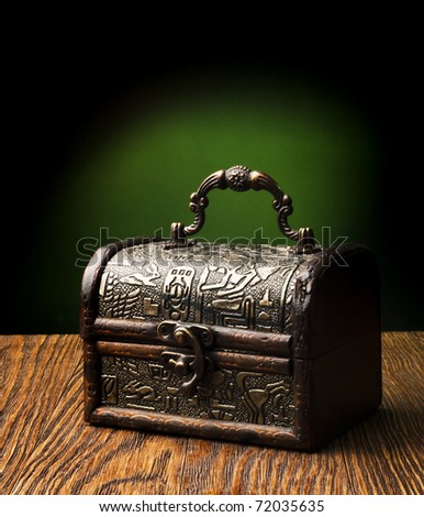 Very old chest in grunge interior. - stock photo