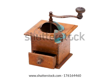 Very old coffee grinder with open drawer isolated on white background - stock photo