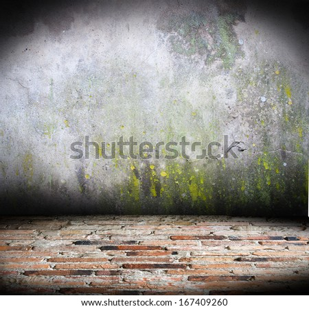 very old concrete wall with brick floor - stock photo