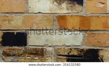 Very old damaged wall of orange bricks - stock photo