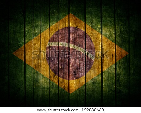Very old dark brown wooden planks background with Brazil flag painted on it - stock photo