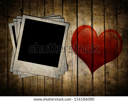 Very old dark brown wooden planks background with photo frames and heart shape - stock photo