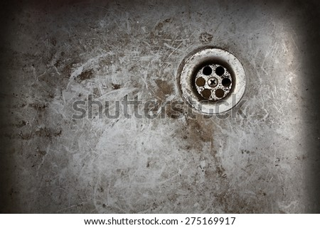 very old dirty sink with rusty metal drain
