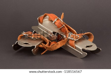 Very old dutch ice skates for a small child, isolated