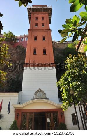 Very old elevator tower still working, Izmir, Turkey - stock photo