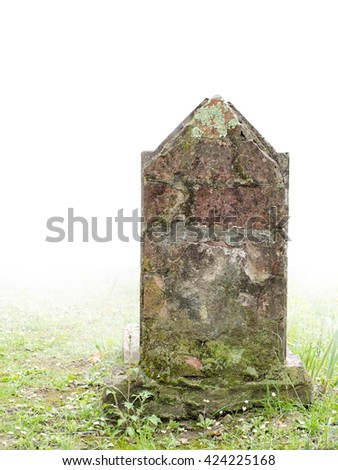Very old gravestone, foggy fading to white background. No wording visible. Halloween maybe? - stock photo