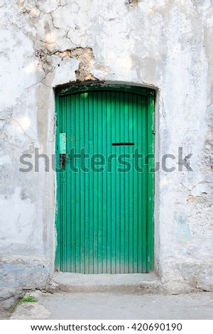 very old green wooden door - stock photo