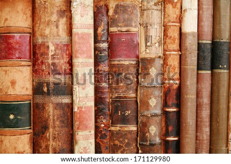 very old historic ancient books on a shelf - stock photo