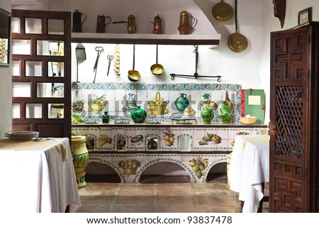 Very old kitchen with ancient utensils - stock photo