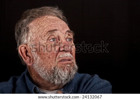 very old man grieving over loss, over black - stock photo