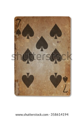 Very old playing card isolated on a white background, seven of spades - stock photo