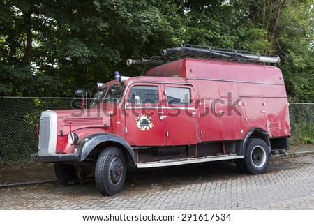 very old red mercedes fire truck parked in the netherlands - stock photo