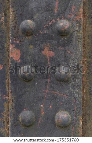 Very old rivets, detail of an iron railway bridge. - stock photo