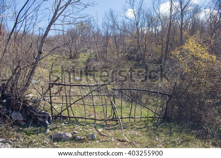 Very old rural fence gate - stock photo