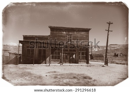 Very old sepia vintage photo with crooked abandoned building in old western city in Bodie Ghost Town  - stock photo