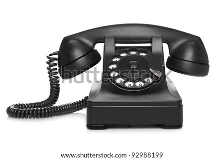 Very old telephone (1937) on white background - stock photo