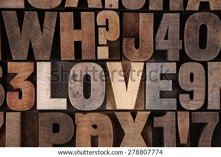 Very Old Vintage Letterpress Letters Spelling out Love - stock photo