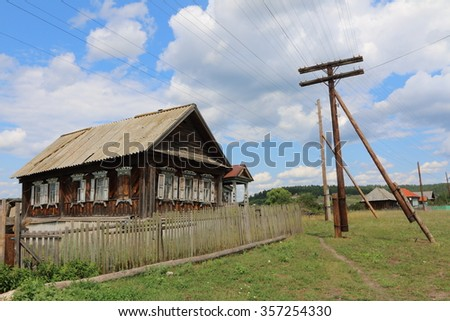 Very old wooden house in the remote Russian village in the summer