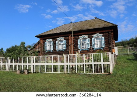 Very old wooden house in the remote Russian village in the summer against a blue sky