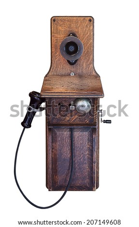 Very old wooden telephone on wall - stock photo