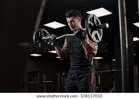 very power athletic guy bodybuilder , execute exercise with dumbbells - stock photo