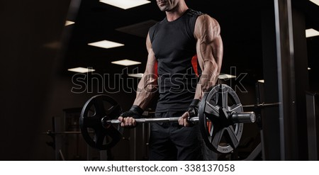 very power athletic guy bodybuilder , execute exercise with dumbbells, - stock photo