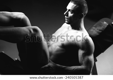 very power athletic guy, execute exercise in sport hall