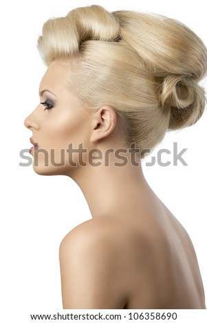 very pretty blonde woman with elegant hairstyle, she is turned in profile at right and looks in front of her - stock photo