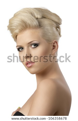 very pretty blonde woman with elegant hairstyle, she is turned of three quarters at right and looks in to the lens - stock photo