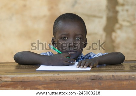 Very Proud Black African Boy Posing Under The Sun - stock photo