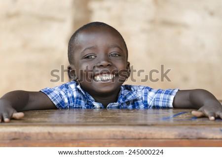 Very Proud Black African Boy Posing Under The Sun - stock photo