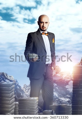 very rich man in a suit with a bundle of money. Business concept - stock photo