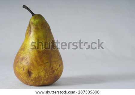 Very Ripe Healthy Pear on a White Background - stock photo