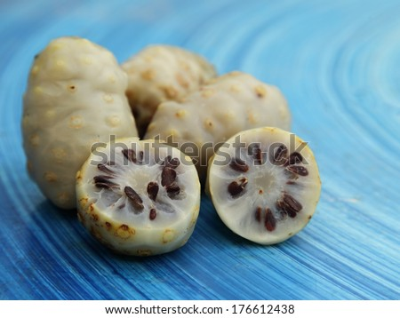 Very ripe Noni fruit or Indian Mulberry (Morinda Citrifolia Linn)  - stock photo