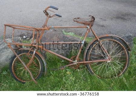 very rusty old bike - stock photo