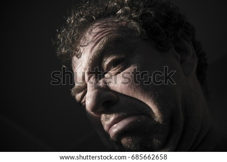 Very sad man portrait. Close-up