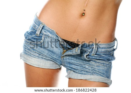 Very sexy belly  of a women weared jeans shorts