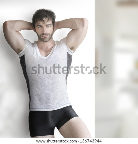 Very sexy young male muscular model in tee-shirt and underwear - stock photo